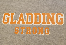 Gray T-shirt with the words GLADDING STRong in orange