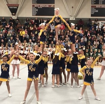 Photo of FW cheerleaders performing their routine at Clovis West Spirit Night