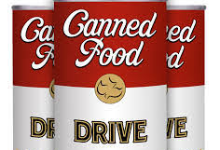 Image of three red and white soup cans that say Canned Food Drive