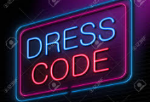 Lighted neon sign that says Dress Code