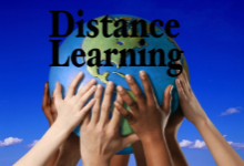 """Picture of student hands of all races touching a world globe with the words """"Distance Learning"""" written across it in black lettering."""