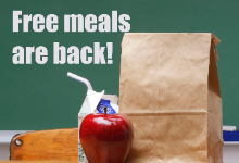 "Image of a brown sack lunch, an apple, and a carton of milk with a straw coming out of it, with the words ""Free meals are back!"""