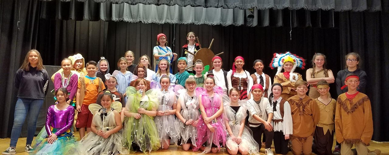 FW drama students pose for a group photo in their Peter Pan Jr. costumes.
