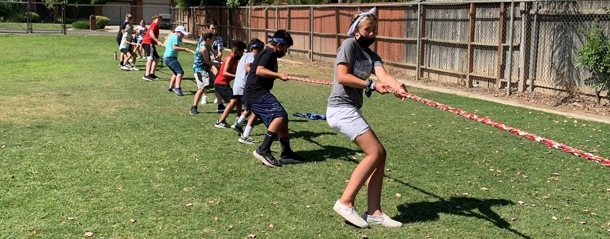 Image of the overall FW Olympic Day 2021 champions participating in the Tug of War event.