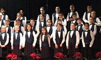 Photo of FW Choir performing at the Winter Holiday Program.